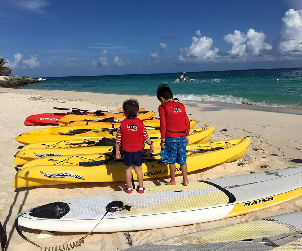 Two boys getting ready for watersports on Necker Island