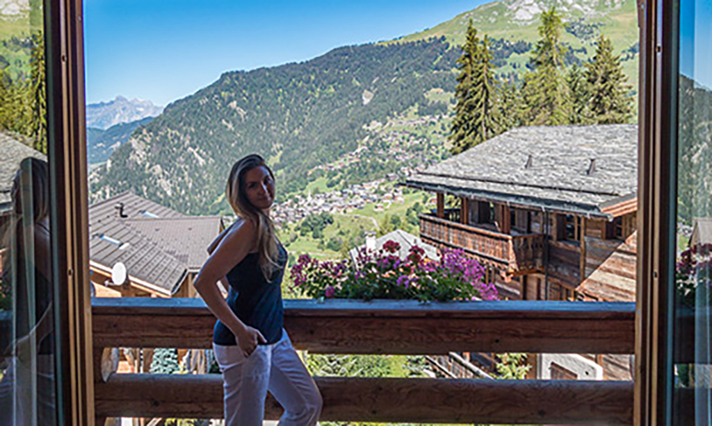 Veronica standing on her room balcony at The Lodge
