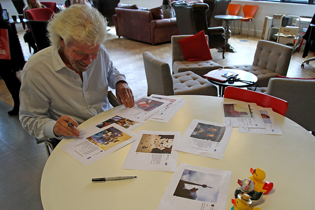 Sir Richard Branson signing Give a Flying Duck pictures