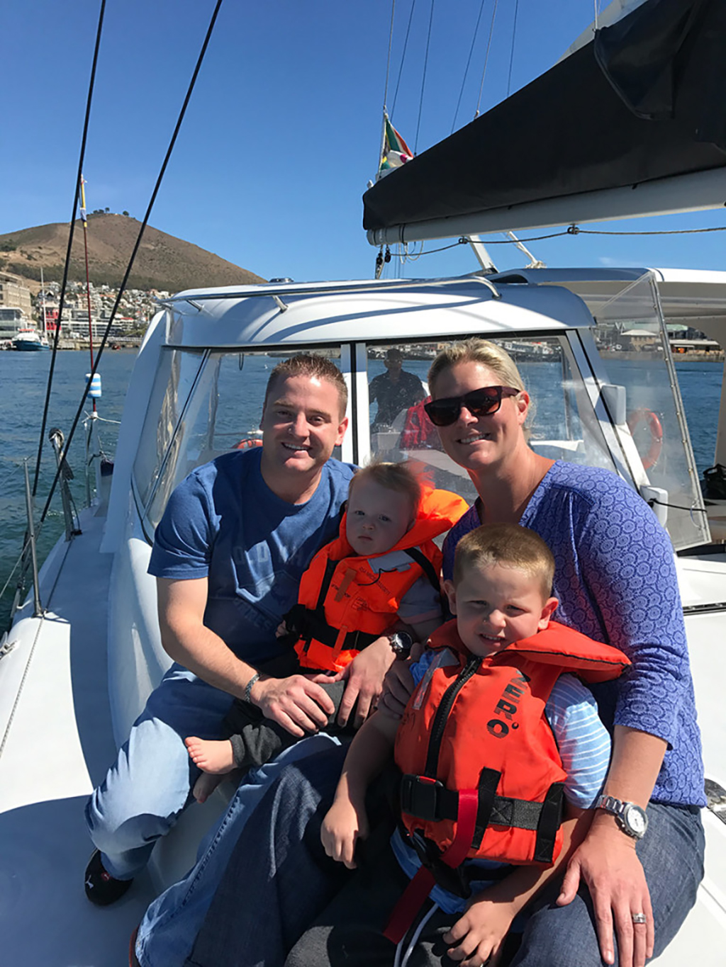 James Basson with his family on a boat