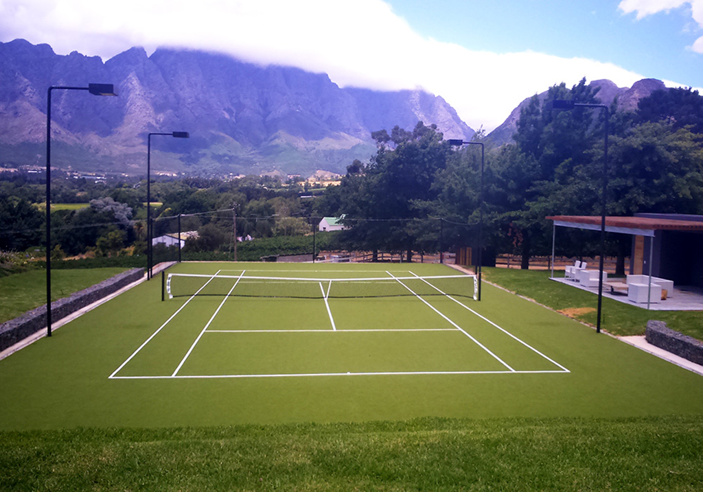 The grass tennis court at Mont Rochelle