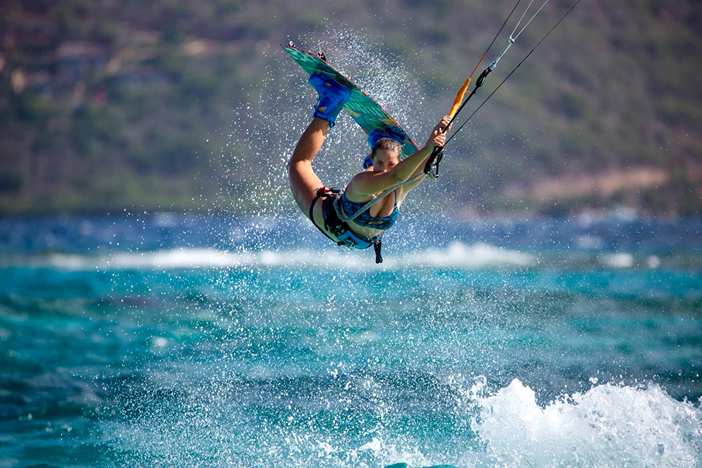 Brianna doing tricks while kitesurfing