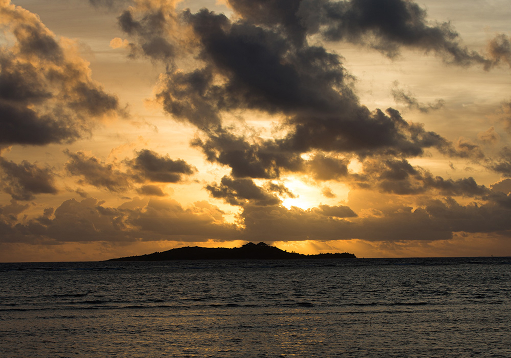 A view of Necker Island from Moskito Island at sunset