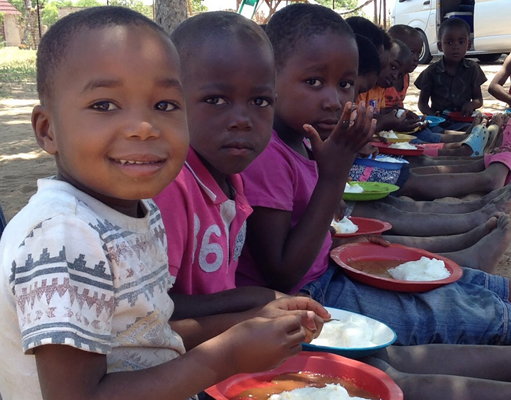Children enjoying some lunch who have received donation from Pride'n Purpise